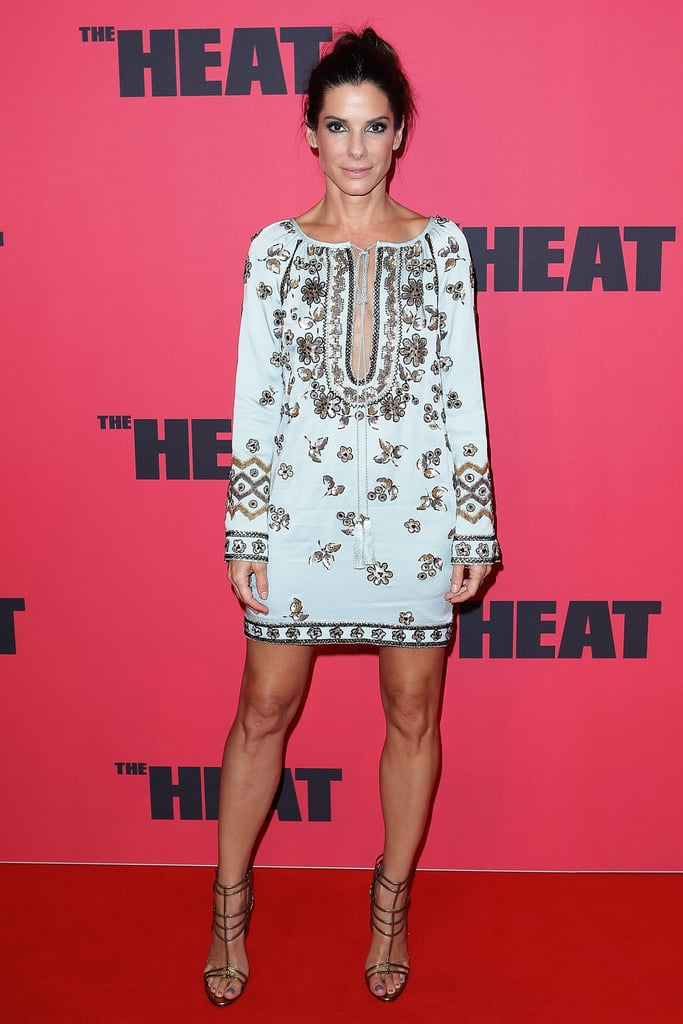 Dazzling the Sydney crowds in a seafoam Emilio Pucci dress, heavy with embellishments, Sandra showed off her killer pins and effortless style. She looks so at ease in this; she could be popping off to the beach if it weren't for the strappy heels.