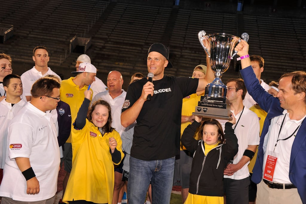 Tom Brady participated in the Best Buddies Challenge in Massachusetts over the weekend. He's been affiliated with the philanthropic organization, which raises funds and awareness for people with intellectual disabilities, for 10 years. As part of his work with the charity, Tom played quarterback in a Friday football game at Harvard Stadium. The fun continued on Saturday, when he participated in a bike ride from Boston to Hyannis Port and celebrated at an awards bash later that evening.  Last week, Tom hit the playground with his wife, Gisele Bundchen, and son Benjamin. Gisele has since traveled to Brazil, where she made an appearance at the Green Nation Fest.