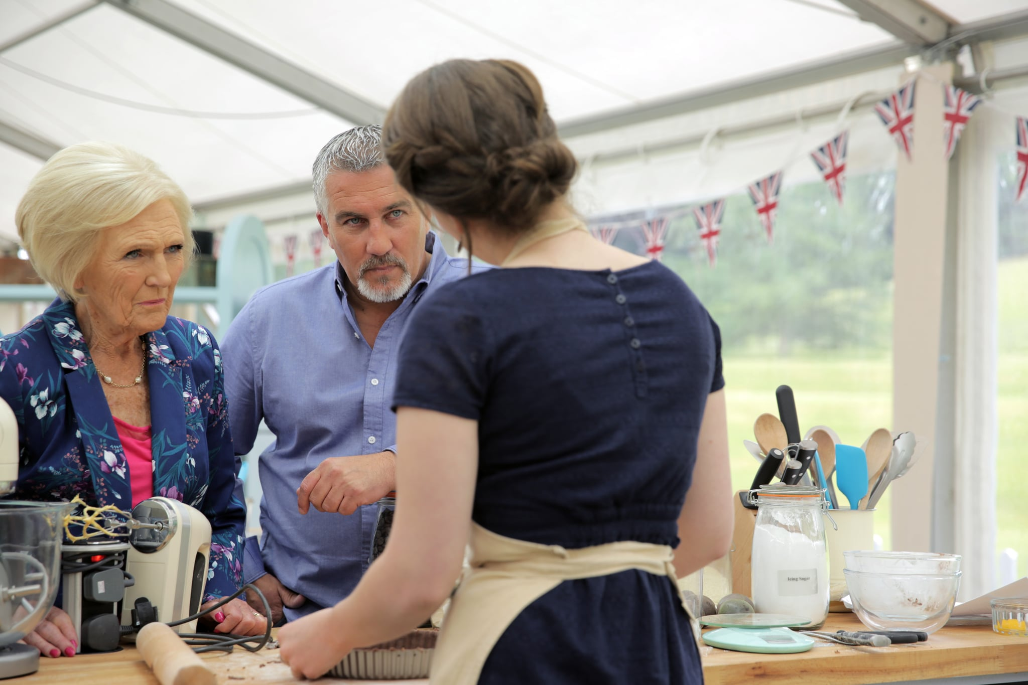THE GREAT BRITISH BAKE OFF (aka THE GREAT BRITISH BAKING SHOW), from left: judges Mary Berry, Paul Hollywood, Flora Shedden (back to camera), 'Episode 9: Chocolate', (Series 6, ep. 609, originally aired in U.K. on Sept. 30, 2015). photo: PBS/Love Productions / Courtesy: Everett Collection