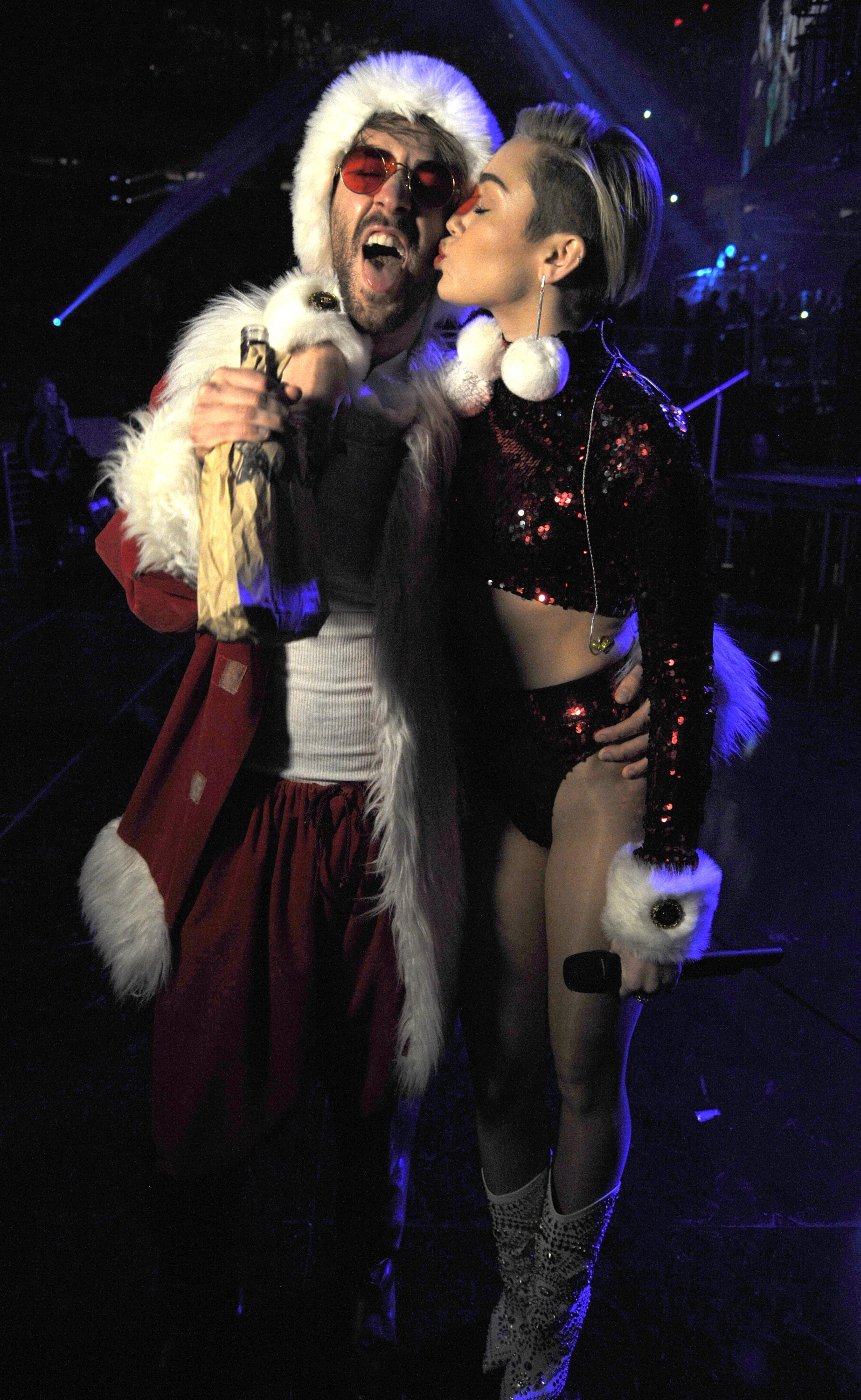 Miley Cyrus planted a smooch on her Santa Claus ...