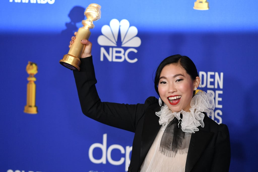 "Awkwafina put a modern spin on a few classic fashion and beauty staples at the Golden Globes on Sunday night. Before making history as the first Asian actor to win the award for lead actress in a movie comedy/musical, the Farewell star hit the red carpet in a black and cream Christian Dior gown with a ruffled collar that she wore under a black blazer.  She paired the dress with an untraditional nail look, the ""french moon"" manicure, in which the white color that's normally used to trace a crescent shape along the tips is replaced with a dark or metallic color. According to a few of her most recent Instagram posts, the nail art was designed by celebrity manicurist Thuy Nguyen, who also created trippy nail art for Joey King at the show. Read ahead to see a few more photos of Awkwafina's take on the french moon manicure.      Related:                                                                                                           I Wouldn't Mind If Hunter Schafer Flipped Me the Bird With Her Insane Bedazzled Finger"