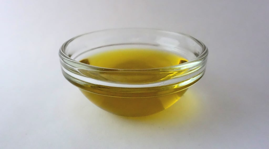 Dabbing nails in olive oil for a healthier look.