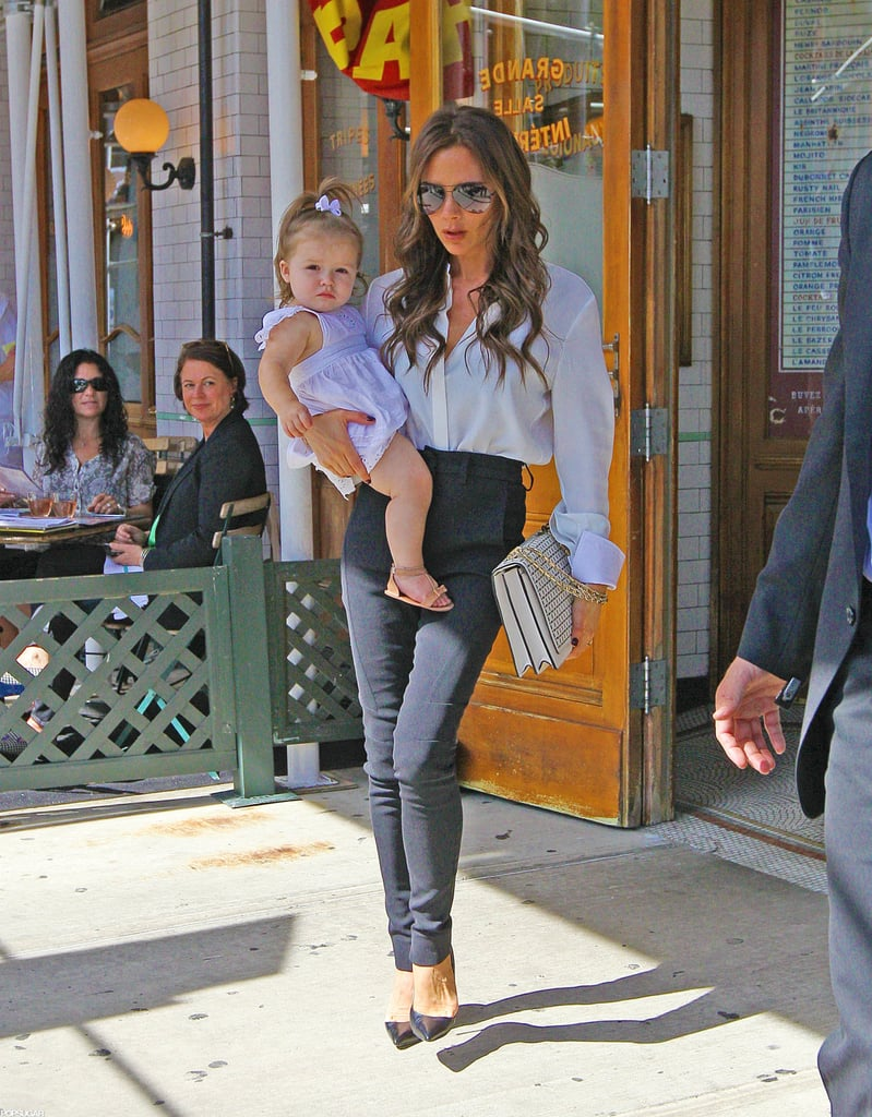 "Victoria Beckham wore a white button-down and black pants to take herself to lunch at Pastis this afternoon in NYC with her 1-year-old daughter, Harper Beckham. The girls had something to celebrate, since Posh just finished up her second show during NYFW. Today, she sent her Victoria, Victoria Beckham designs down the runway and hung out backstage in a simple tan dress. Harper earned a place in the collection — Victoria introduced the ""Harper"" shoulder bag! Posh also dished on Harper's love of the runway in a new interview. She said, ""She loves to bomb down [the catwalk]. It's impressive. I had to tweet her doing it the other day. She was storming."" On Sunday, though, her husband, David Beckham, hit Fashion Week to see her Victoria Beckham Collection presentation. Posh is a mainstay at NYFW, and got a head start on the celebration by joining Anna Wintour for a special Fashion's Night Out event at Bergdorf Goodman."
