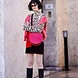 Liven up a simple miniskirt with an animal-print top and a neon bag.