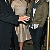 Jennifer Lopez wore a belted coat while Casper Smart was in olive green.