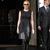 Kylie Minogue is the epitome of Parisian chic in a gray dress and lace-up, peep-toe boots.