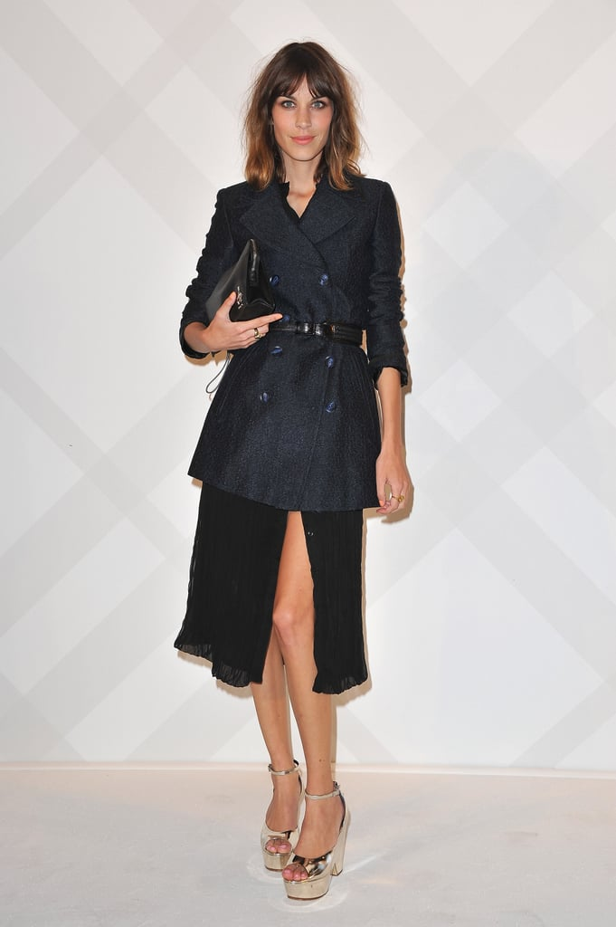 Alexa's got a great collection of coats, doesn't she? Here she styles a navy double breasted topper over a floaty black dress.