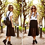 You can punch up your t-shirt MO with a flirty pleated midi skirt. Photo courtesy of Lookbook.nu