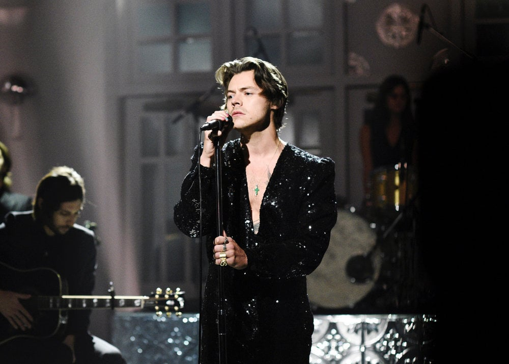 "Harry Styles made his Saturday Night Live hosting debut on Nov. 16, and he absolutely nailed it. Why yes, I'm talking about his manicure. The ""Lights Up"" singer is the latest star to try the ""Skittles"" manicure trend, sporting a different shade on each nail. Styles's chosen polish look went with the variety of outfits he wore during the evening — from a sparkling sequined jumpsuit to an all-red suit ensemble.  ICYMI, the ""Skittles"" manicure is sweeping Instagram with its fun multicolored shades. We saw Styles dabble in a similar style back in May when he attended the 2019 Met Gala, but this look is even bolder. Ahead, see more photos of Styles's latest look.       Related:                                                                                                           These Are the Best and Most Over-the-Top Nail Art Looks of 2019 So Far"