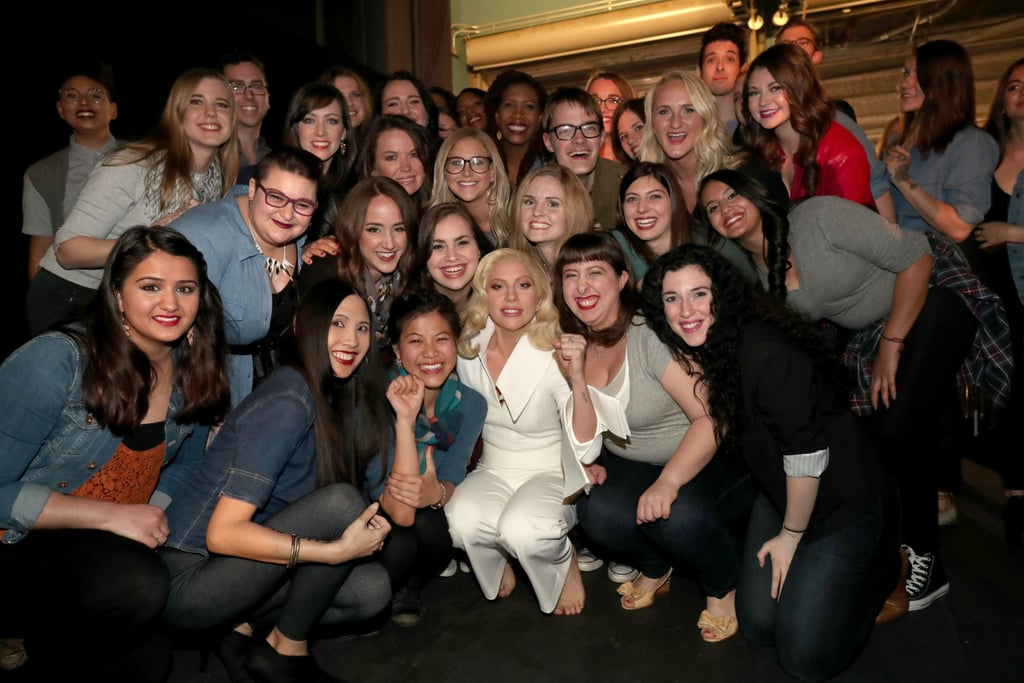 Lady Gaga posed backstage with the group of sexual abuse survivors who participated in her epic performance.