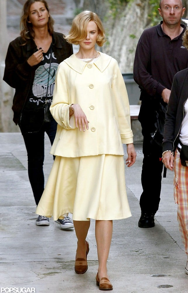 Nicole Kidman got into character as Grace Kelly to film her latest movie, Grace of Monaco, in Menton, France, today. Nicole transformed into the actress-turned-princess wearing a yellow jacket and matching skirt with penny loafers on set. She's on location in France following a string of promotional stops for her highly anticipated but controversial upcoming film, The Paperboy, in which she stars opposite Zac Efron and Matthew McConaughey. Nicole also squeezed in time with husband Keith Urban last week. Nicole and Keith hit the red carpet during the New York Film Festival, where she was honored with a gala tribute.