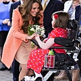 Kate Middleton chatted and smiled with a little girl named Sally Evans during her visit to the Naomi House Children's Hospice in April.