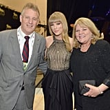 During the Academy of Country Music Awards in April 2013, Taylor posed with her mom Andrea and dad Scott backstage.