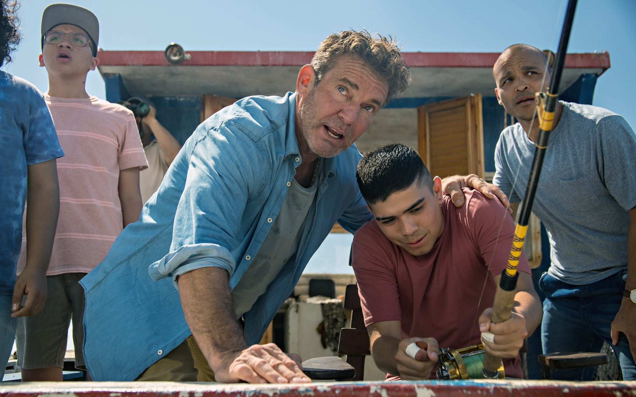 BLUE MIRACLE, centre: Dennis Quaid, right: Jimmy Gonzales, 2021. ph: Carlos Rodriguez /  Netflix /Courtesy Everett Collection
