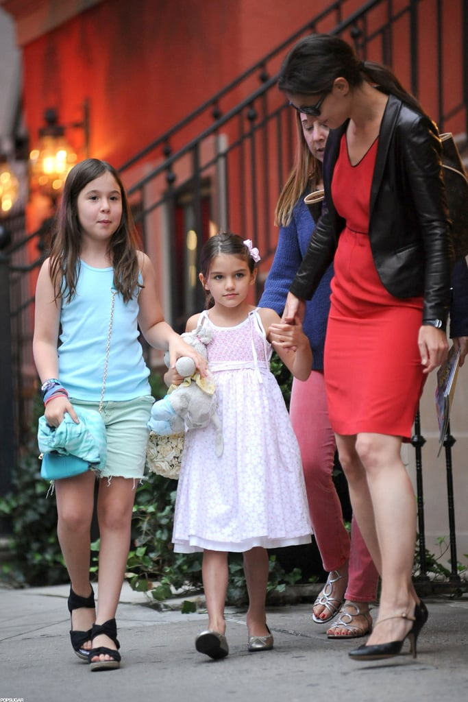 Katie Holmes and Suri Cruise left their NYC apartment yesterday afternoon, hopped in a cab, and met up with friends at Alice's Tea Cup. The kid-friendly tea shop is one of Suri's favorite places in the Big Apple. They're back in Manhattan after a trip away last weekend. One of their many Summer getaways was to visit with Katie Holmes's family in Ohio. Suri's presently gearing up for her very first year of school, but that's not her only big-girl milestone. On Saturday, Katie taught Suri to ride a bike along the West Side Highway's bike and pedestrian stretch.