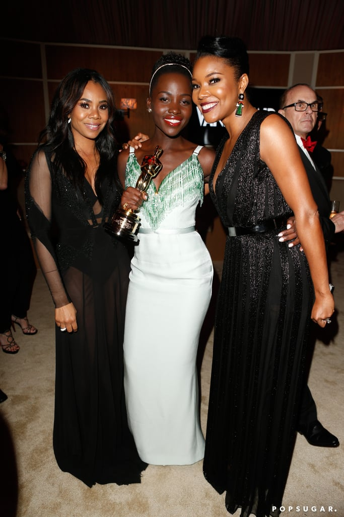Lupita Nyong'o held on to her best supporting actress Oscar while posing pretty with Regina Hall and Gabrielle Union.