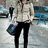 She came equipped with all the essentials — by that we mean, a quilted puffer and a Chanel bag.