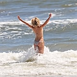 Julianne Hough ran into the water in her bikini.
