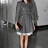 Alexa Chung showed off a classic look in a belted trench and ankle-strap heels at Christopher Kane.