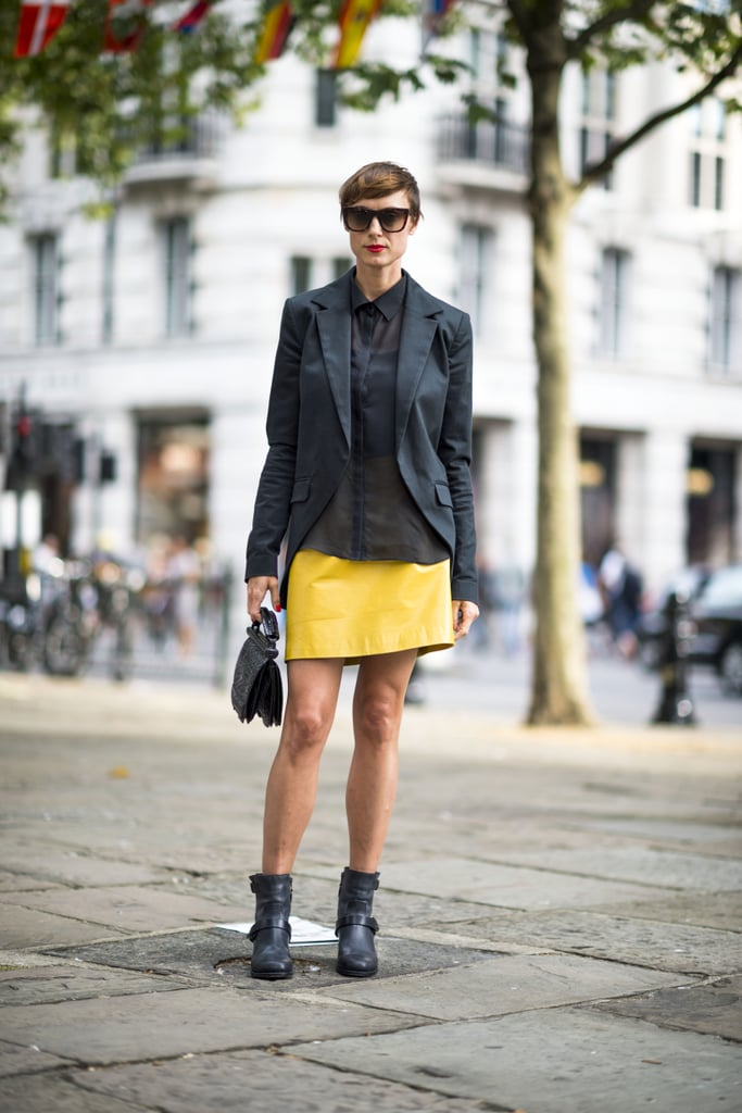Capitalize on a fresh wash of color, albeit with seasonal contrasts. This bold yellow miniskirt got a Fall twist with motorcycle boots and a black blazer. Source: Adam Katz Sinding