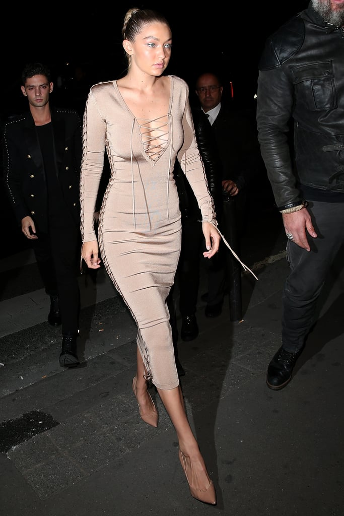 Gigi slid into a slinky lace-up dress for the Balmain after-show party.