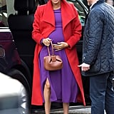 Meghan didn't shy away from colour whatsoever when she styled this Babaton purple midi with a cherry Sentaler coat and covetable Gabriela Hearst handbag for a visit of Birkenhead at Hamilton Square in January 2019.