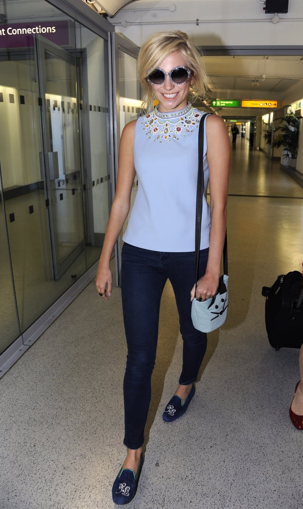 Loving Pixie Lott's off-duty airport style — that embellished blue blouse is both glam and demure, and the navy blue loafers lend the whole look a preppy feel. Cute!
