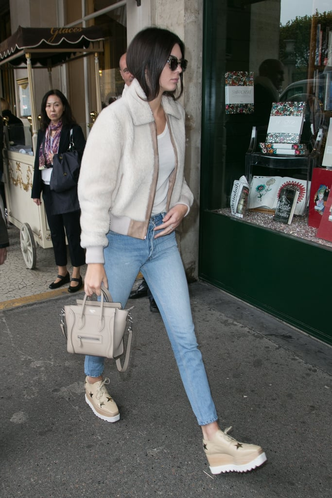 Wearing Komono sunglasses, Stella McCartney creepers, and carrying a Céline bag.