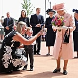 During a June visit to Liverpool, Queen Elizabeth received a bouquet of flowers from a very young admirer.
