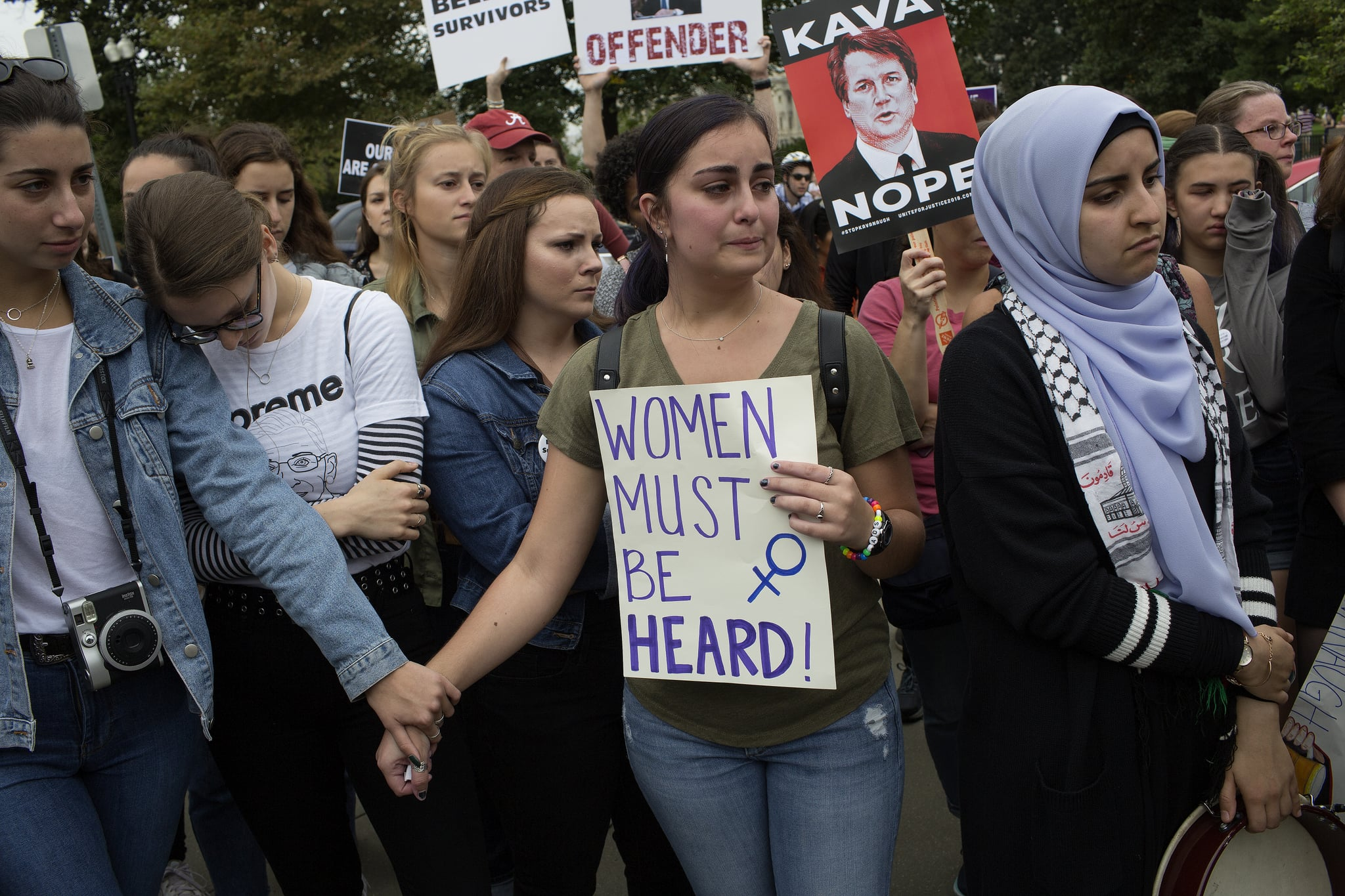 WASHINGTON, D.C. - OCTOBER 6: As the United States Senate prepares to vote to confirm Judge Brett Kavanaugh's nomination to the Supreme Court, women opposed to his nomination gather in front of the Supreme Court to share their stories of sexual assault on October 6, 2018 in Washington, D.C.. (Photo by Andrew Lichtenstein/Corbis via Getty Images)