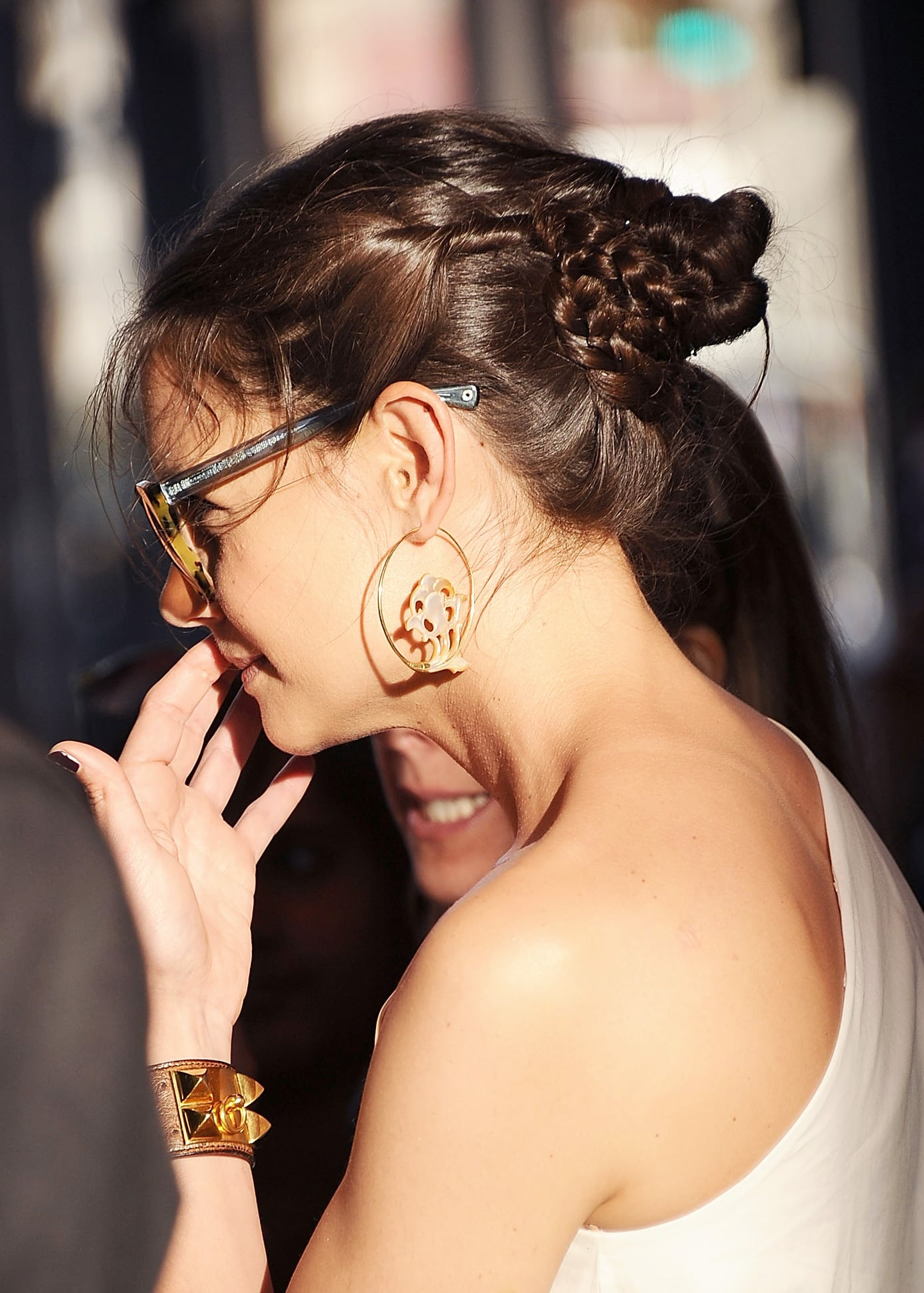 Katie Holmes wore her braided bun with twists on either side.
