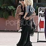 Ashlee Simpson carried Bronx Wentz to her car.