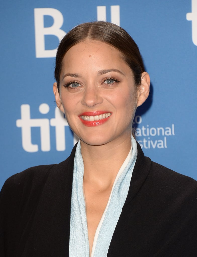At the Blood Ties press conference, Marion Cotillard looked professional yet chic with a sleek updo and coral lip.