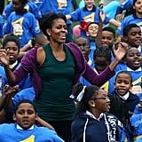 Michelle Obama goes for the jumping-jack world record.