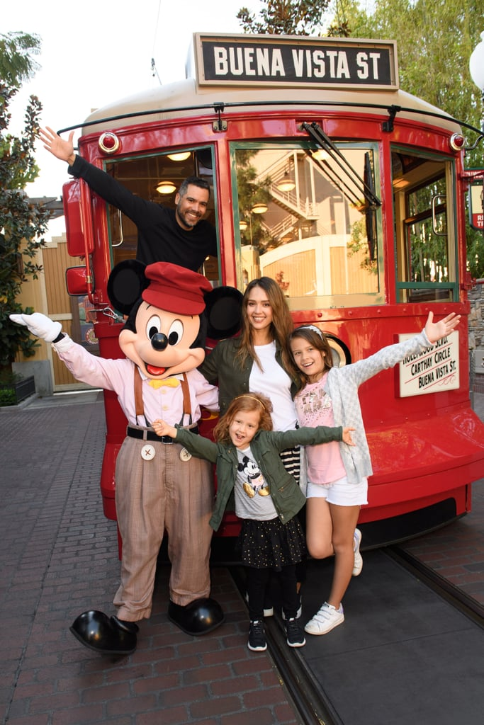 Jessica Alba and her family were in the mood to visit the happiest place on Earth, and it shows. The beautiful family were caught having a blast at Disney California Adventure and stopped to snap some photos with none other than Mickey Mouse.    Cash Warren looked very handsome in a black jacket, while Jessica was giving us serious boho-chic vibes with her olive coat, white tee, black jeans, and striped sweater tied around her waist. Haven looked like a carbon copy of her mom, wearing a very similar outfit, while Honor rocked shorts and a pink tee. The mommy of two was so enamored by Mickey, she even stopped to take some selfies with him.      If you want to see this famous family smiling from ear to ear, scroll down for more photos and then check them out again supporting Cash at the launch of his sock line, Pair of Thieves.       Related:                                                                                                           Take a Scroll Through 19 Years' Worth of Jessica Alba's Style