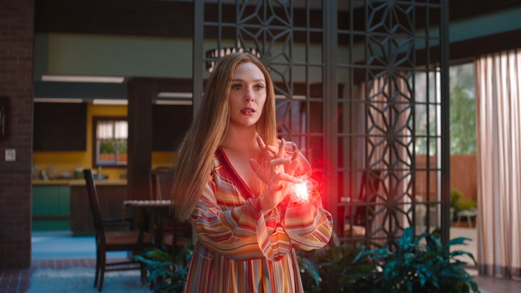 Elizabeth Olsen as Wanda Maximoff in Marvel Studios' WANDAVISION exclusively on Disney+. Photo courtesy of Marvel Studios. ©Marvel Studios 2021. All Rights Reserved.