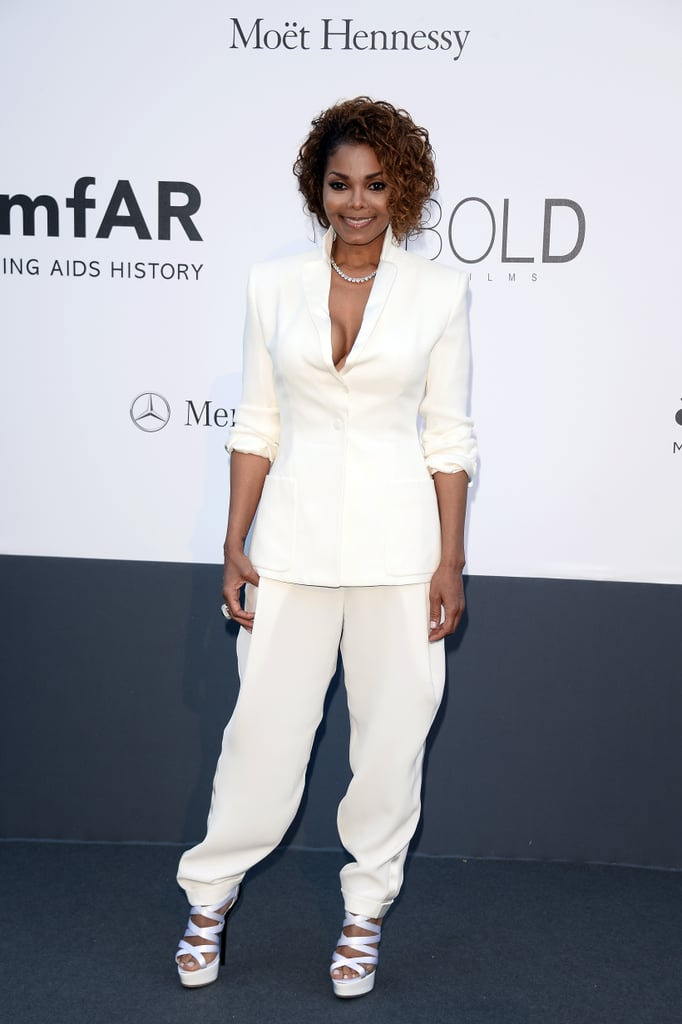 Janet Jackson rocked a crisp white Giorgio Armani suit with matching strappy sandals, then added a diamond necklace for shine.