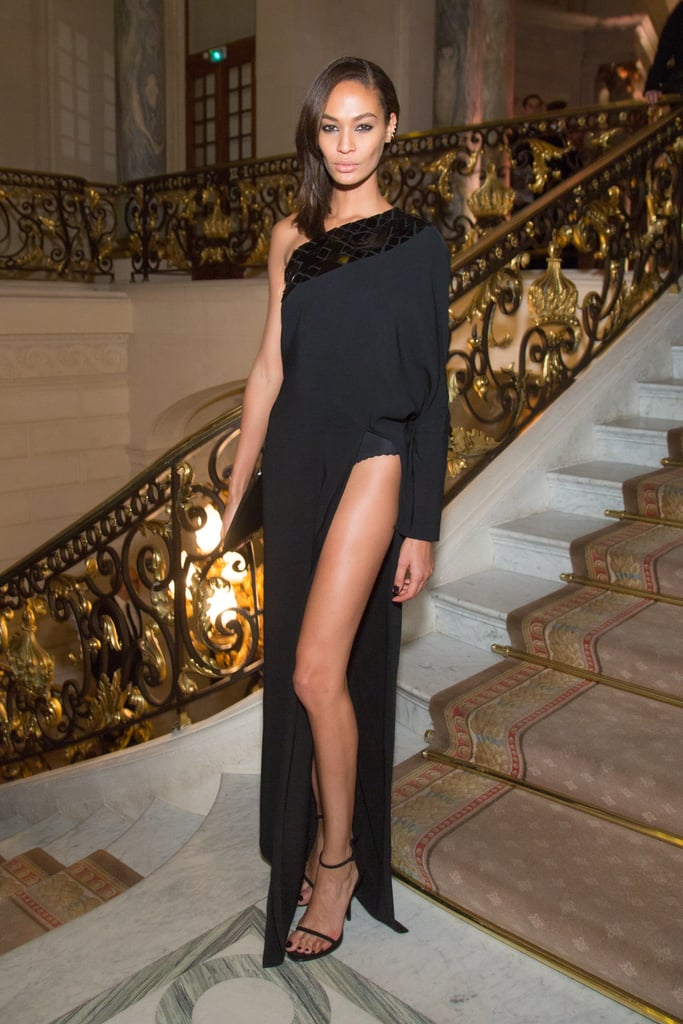 Joan Smalls made the sexiest arrival at Carine Roitfeld's CR Fashion Book party in Paris, showing off her supermodel stems in a sultry slit gown.