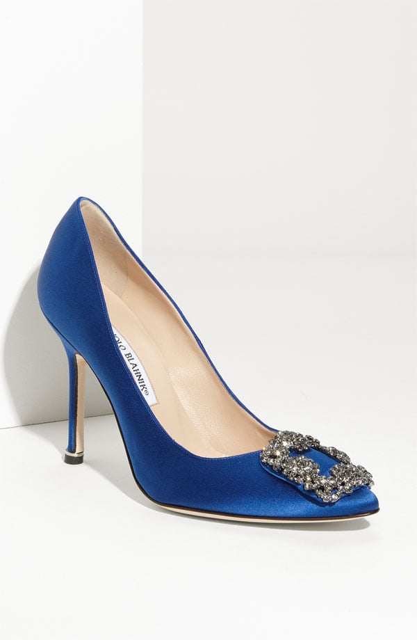 "Adhering to the ""something blue"" — and the ""something new"" — wedding tradition, we couldn't help but fall in love with this gorgeously bejeweled pair of Manolos. Imagine having these blue pumps peeking out from beneath your white gown — it's a subtle sapphire accent perfect for your big day. Manolo Blahnik Something Blue Satin Pump ($945)"