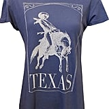 For laid-back days, rock this vintage-inspired t-shirt (Western print included) with boyfriend jeans and Chucks. Wildfox Rodeo Rider Love Desert Crew ($64)