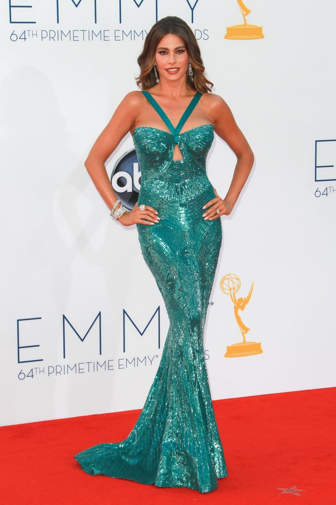 For the 2012 Emmy Awards, the Modern Family star turned up the heat in an allover teal, embellished Zuhair Murad creation. The gown showcased every perfectly toned curve, including a sexy cutout back, while remaining tasteful and glamorous.