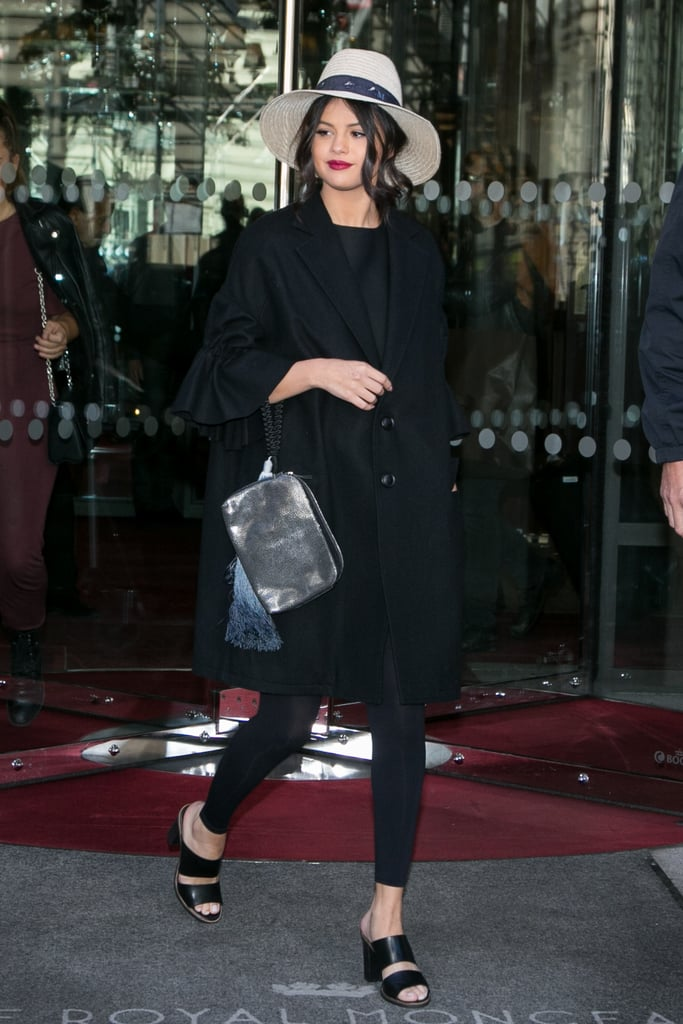 Fall staple: A thick bell-sleeved jacket by Yohji Yamamoto. Selena wore it with: Leggings, a Maison Michel hat, Kurt Geiger sandals, and a clutch by The Row in Paris in September 2015.