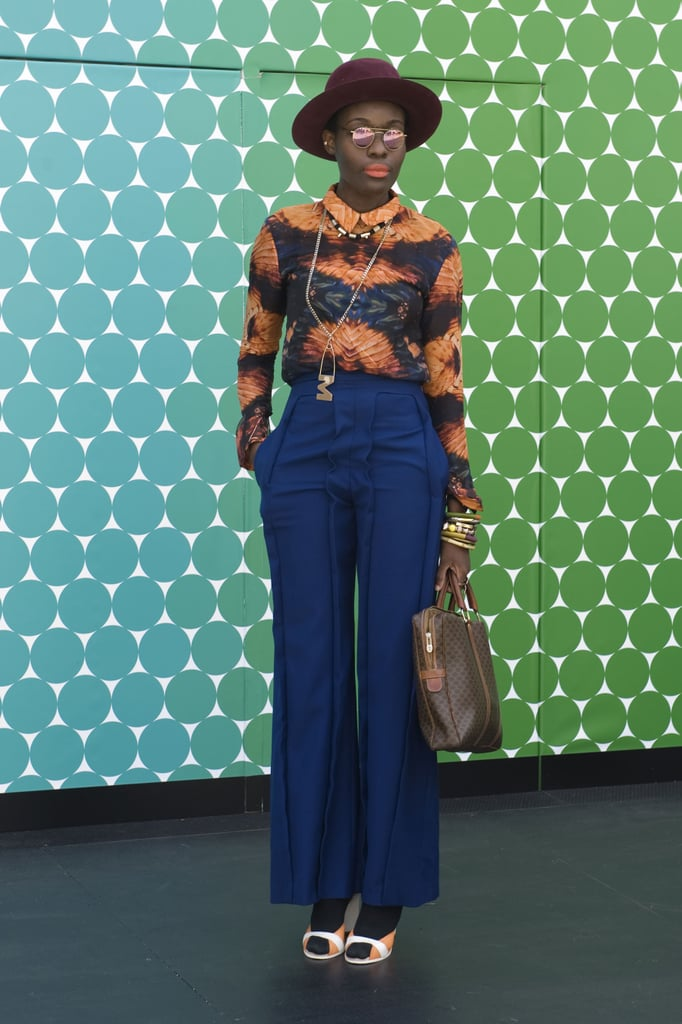 Now this outfit provides us with a serious '70s flashback — yes, we want her high-waisted blue trousers right about now.