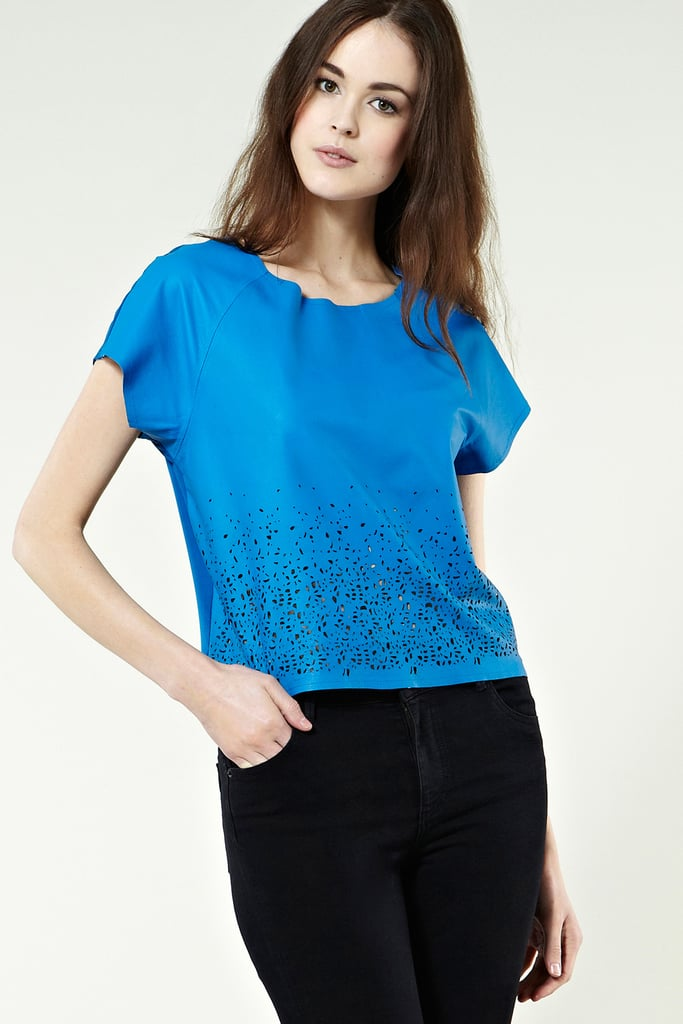 Dress up a more casual look with texture — this bold cobalt blue leather t-shirt surprises with a subtle cutout detail at its hem.