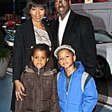 The parents posed with their twins in NYC as they attended the NASDAQ stock market closing bell in December 2011.