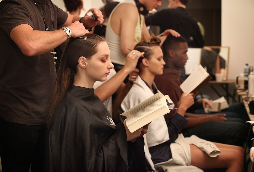 Models busied themselves with books during prep for their London fashion show in 2010.