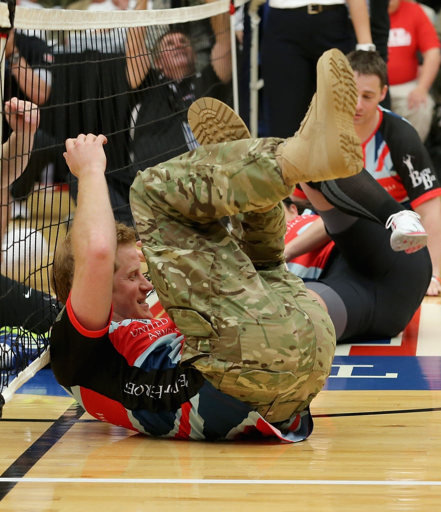 Prince Harry rolled around on the ground while playing sitting volleyball during the Warrior Games in Colorado on Saturday.