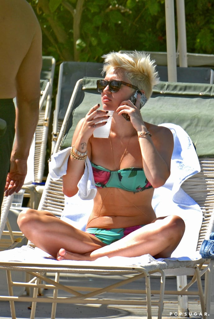 Miley Cyrus sipped on a cold drink poolside.