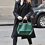 Jessica Chastain was the picture of Winter polish in a classic black coat — and with a gorgeous green Dolce & Gabbana tote in tow.