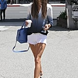 While grabbing coffee in LA, Alessandra Ambrosio sported her white Black Orchid denim cutoffs with a Two by Vince Camuto tie-dyed blouse and a coordinating blue Alice + Olivia satchel.
